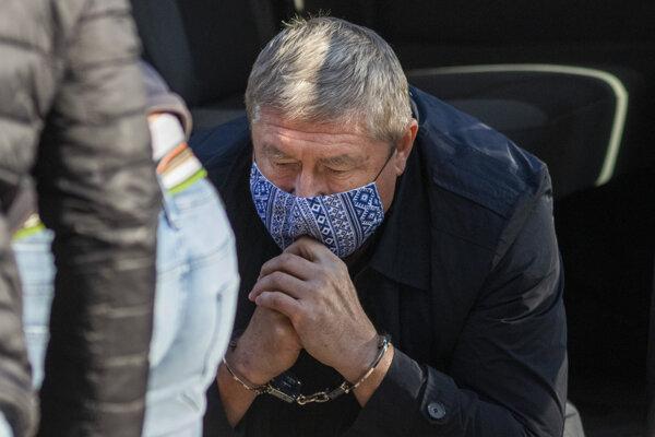 Dušan Kováčik in handcuffs after the police arrested him on October 22.