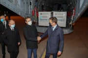 Health Minister Marek Krajčí and PM Igor Matovič shaking hands in front of cargo plane with Sputnik V supplies on March 1.