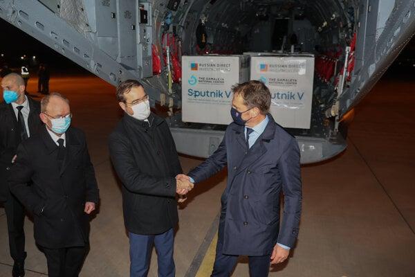 Marek Krajčí and Igor Matovič shaking hands in front of a cargo plane with Sputnik V supplies on March 1.