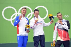 l-r: Jakub Grigar with silver medal, Jiří Prskavec (the Czech Republic) with gold medal, and Hannes Aigner (Germany) with bronze medal
