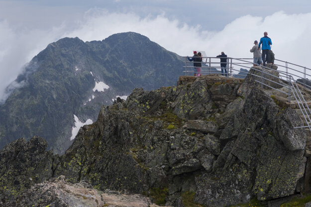 Tourists enjoy the view from Lomnický Štít in the High Tatras.