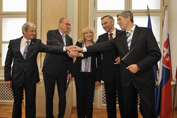 Coalition partners share a united gesture as their election term begins.