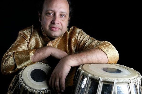 Abhijit Banerjee with him classical instrument .