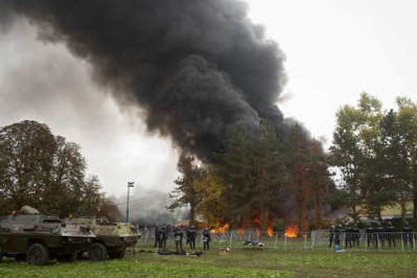 Impatient refugees set some tents on fire on Ocotber 21, in the Slovenian Brezica camp close to Croatian border.