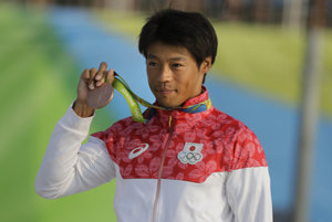 Takuja Haneda and his medal