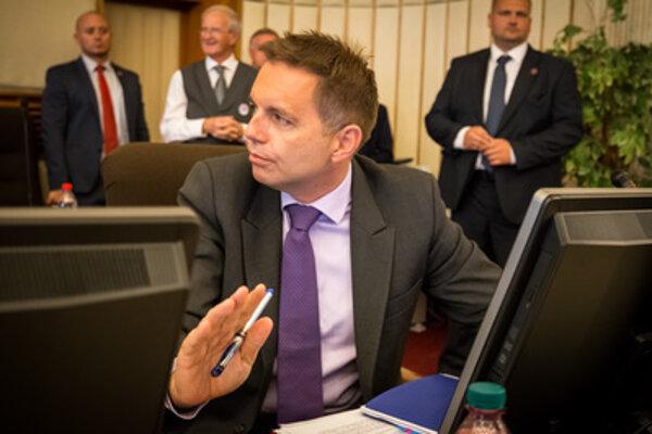 Finance Minister Peter Kažimír during cabinet session.