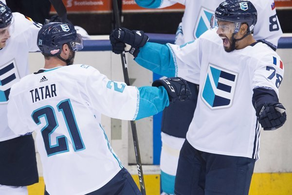 Slovak Tomáš Tatar (L) rejoices after the winning goal at the Hockey World Cup for Team Europe.