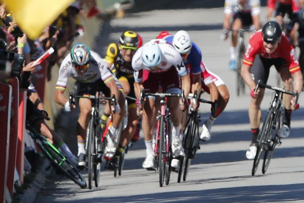 Peter Sagan, left, sprints as Britain's Mark Cavendish crashes, during the sprint of the fourth stage of the Tour de France cycling race.