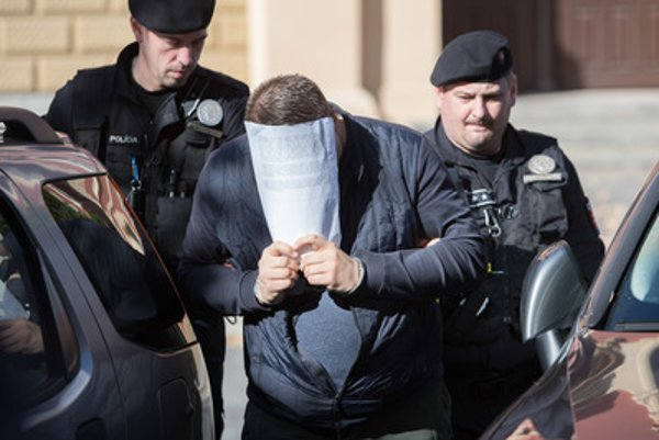 Police bring suspects to the Specialised Criminal Court in Banská Bystrica.