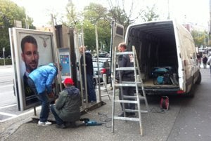 Removing unused telephone booths in the Old Town.