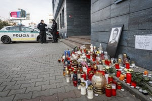 Policemen guard the entrance to offices of news website Aktuality.sk, the employer of the murdered investigative journalist Ján Kuciak, in Bratislava.