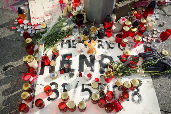 People have lit candles at the place where Henry Acorda was attacked.