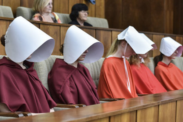 Activists protest silently against tougher abortion law in Slovka parliament, June 13.