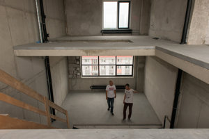 The lofts have generous ceiling height and a multipurpose vertical layout.