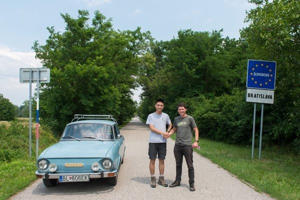 Chinese tourist Charlie (left) with Braňo Chrenka at the former Iron Curtain.