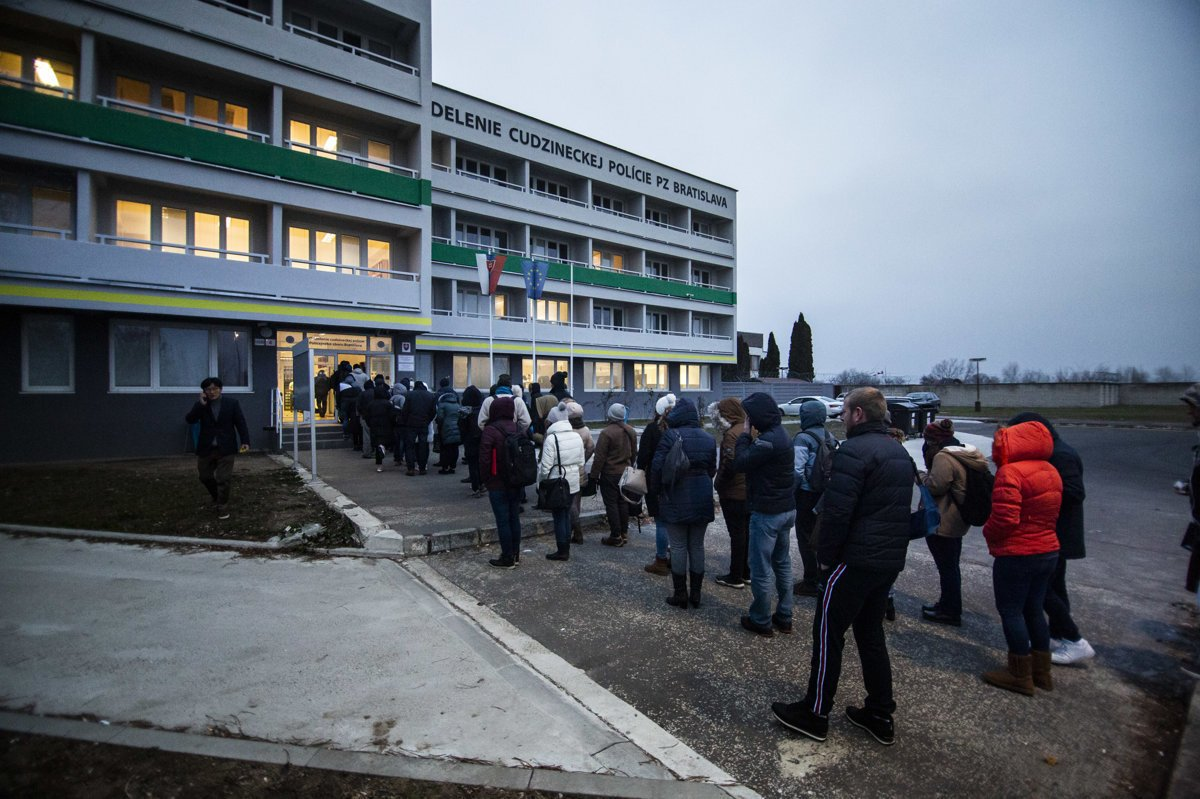 00c0b1c5a People standing in front of the Foreigners Police Department in Bratislava.