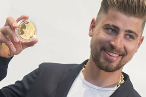 Slovak cyclist Peter Sagan promotes a commemorative medal of his success.