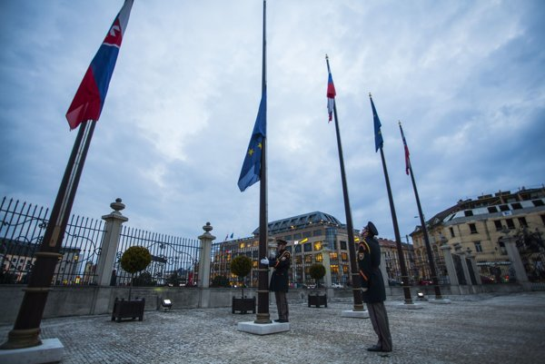 Flags in front of the Presidential Palace fly at half-mast.