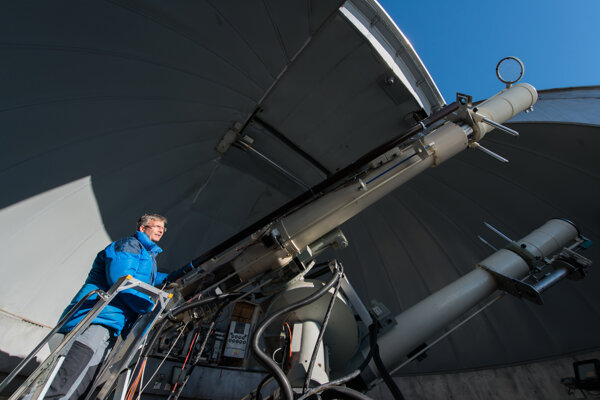 Astronomer Ján Rybák and the coronagraphs in the dome of the observatory at the Lomnický Štít peak.