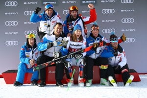 Slovakia's Petra Vlhová celebrates with teammates at the end of an alpine ski, women's parallel slalom World Cup in St Moritz, Switzerland.