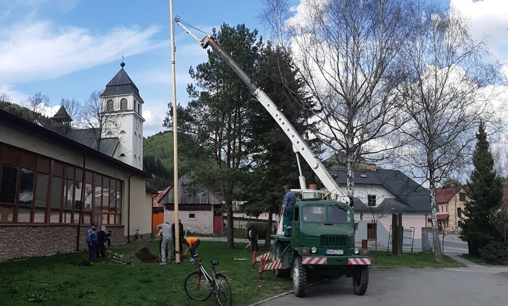 A small group of older Zázrivá locals put up a maypole in the centre of their village on May 1, 2020.