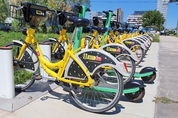 Yellow Slovnaft bikes with green Bolt scooters.