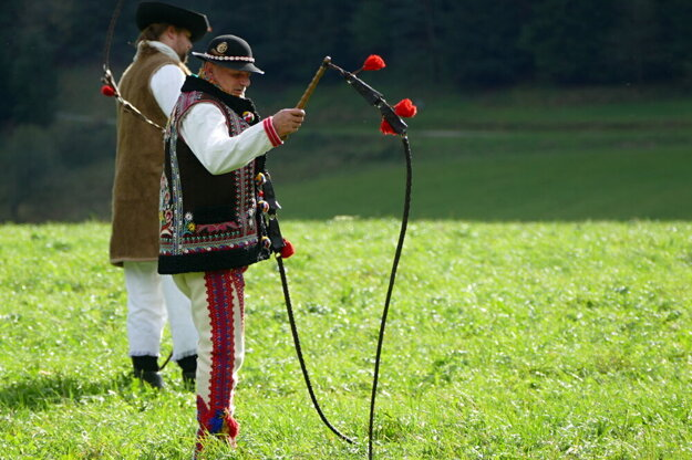 A man holds a whip during a whipping school weekend on October 4, 2020 in Čičmany.