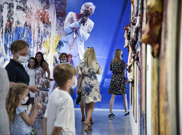 People look at the exhibited works of Juraj Kukura on June 27, 2020.