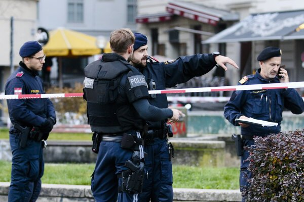 After the shooting, armed police stay in position at the scene in Vienna, Austria, on Tuesday, Nov. 3, 2020.