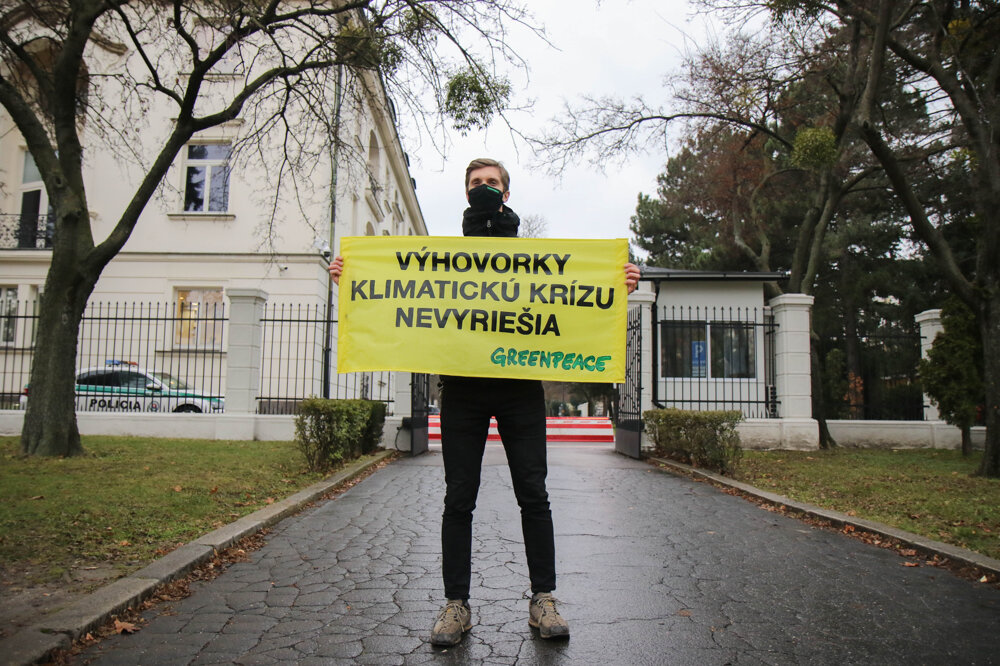 Campaign coordinator Pavol Fábry protests in front of the Government's Office.