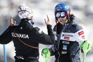 Petra Vlhová listens to her coach Livio Magoni prior to the second run of the women's slalom, at the alpine ski World Championships in Cortina d'Ampezzo, Italy,