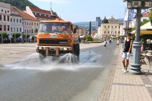 A truck sprays water on the main square in Banská Bystrica on July 7 to cool down the area amid the summer heat.