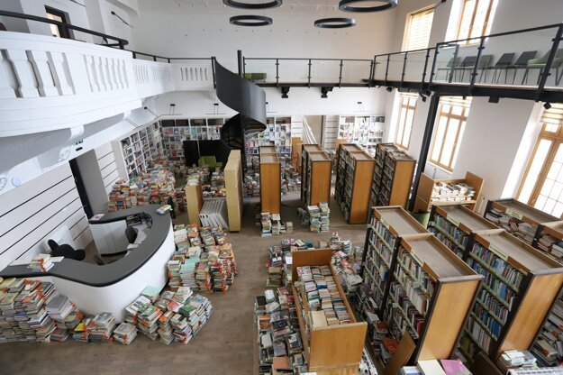 Huge piles of books are stored in the study room of a regional library in Zvolen, central Slovakia, because of reconstruction work.