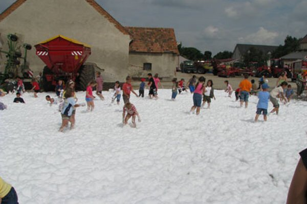These children enjoyed playing in a huge layer of extinguisher foam.