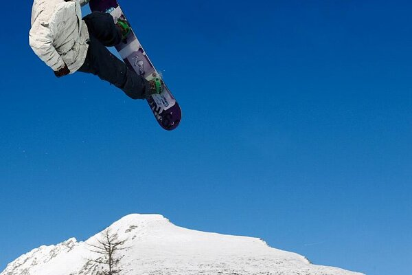 A snowboarder catching air at Štrbské Pleso.
