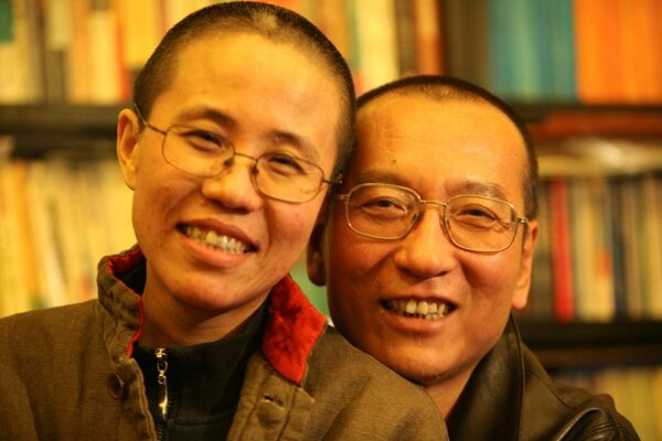 Chinese dissident Liu Xiaobo and his wife Liu Xia pose in this undated photo released by his family on October 3, 2010.