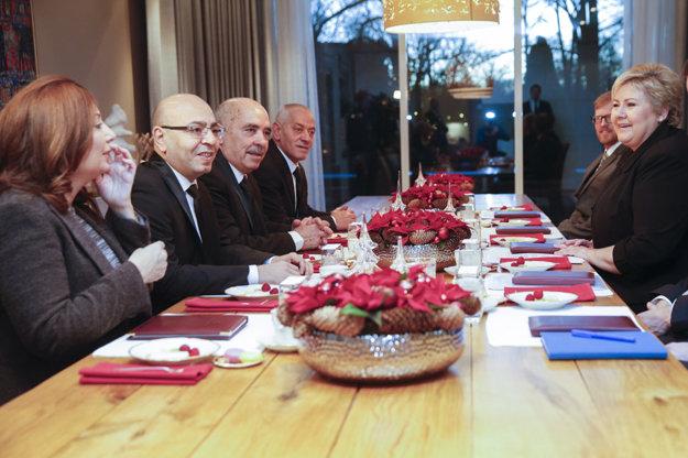 Ocenený Kvartet pri zasadnutí.